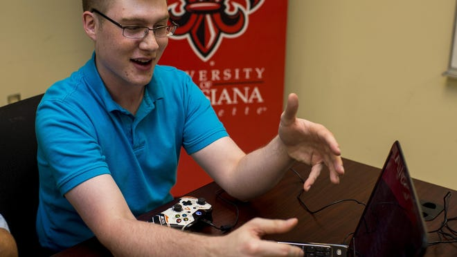 Nicholas Laborde, a UL senior studying management, demonstrates the Raconteur Games video game Close Order.