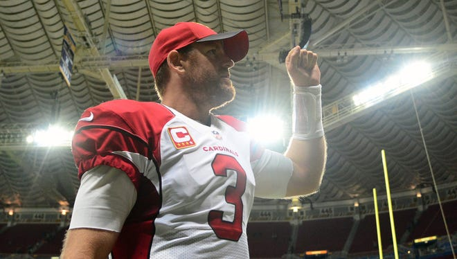 Dec 6, 2015: Arizona Cardinals quarterback Carson Palmer (3) celebrates after defeating the St. Louis Rams 27-3 at the Edward Jones Dome. The Cardinals defeated the Rams 27-3.