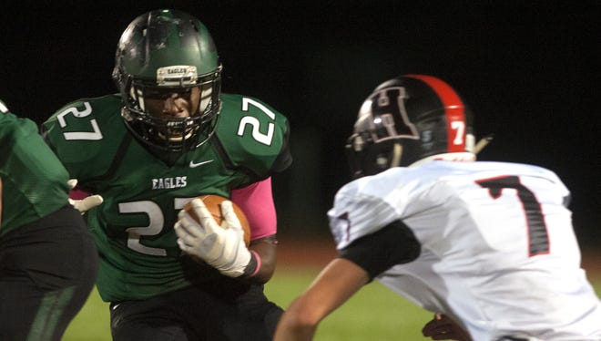 West Deptford's Tyshawn Bookman runs in a 17-14 overtime win against Haddonfield on Oct. 20. The rivals will square off for the South Jersey Group 2 title on Sunday at Rowan University at 11 a.m.