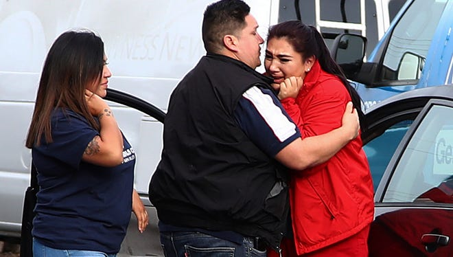 Fernando Juarez (center), embraces his sister Vanessa Flores (right) at the Veterans Home of California on Friday March 9, 2018. in Yountville, Calif. Flores, who is a caregiver at the facility, exchanged texts with family while sheltering in place.