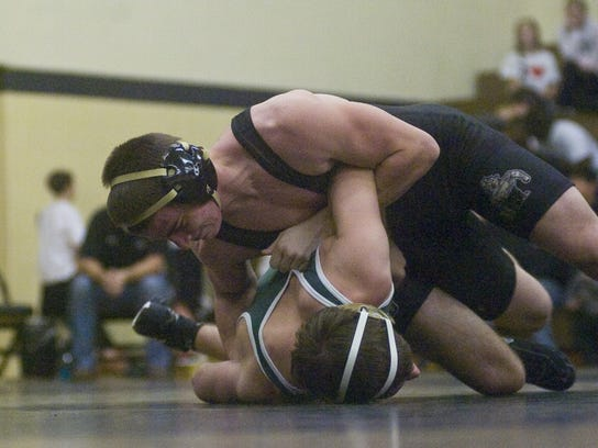 Biglerville's Dustin Grubbs shown turning Carlisle's Dan King would have qualified for the PIAA tournament last year with this year's 20-man bracket. (The Evening Sun -- Shane Dunlap)