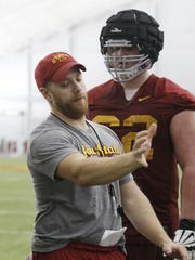 Offensive coordinator Tom Manning leads players through practice Tuesday, March 8, 2016, during spring practice in the Bergstrom Football Complex at Iowa State University in Ames.