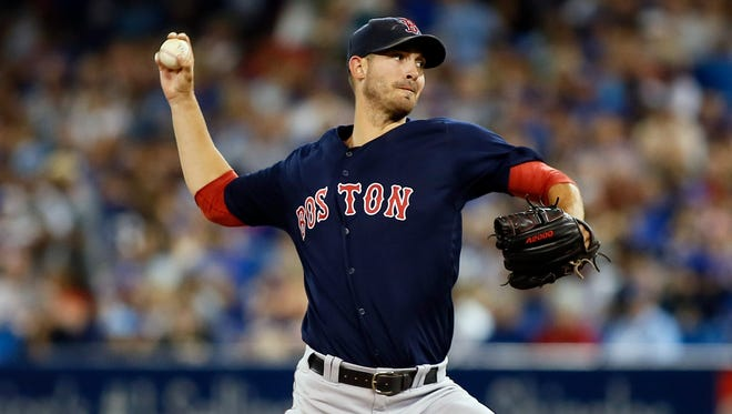 Boston Red Sox starting pitcher Rick Porcello throws against the Toronto Blue Jays.