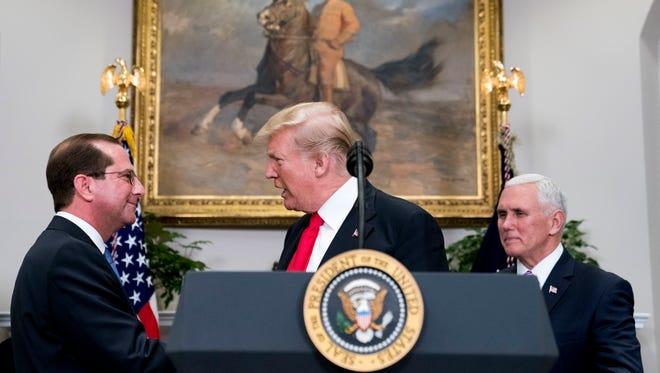 Health and Human Services Secretary Alex Azar, President Trump and Vice President Pence.