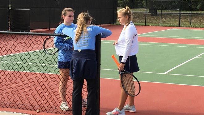 Hayden tennis coach Christy Sheetz talks to Wildcat doubles players Allyson Meier, left, and Jenny Voegeli during Friday's Class 4A state quarterfinal. Meier and Voegeli took a 6-4, 6-0 win over Parsons to advance to Saturday's state semifinals.