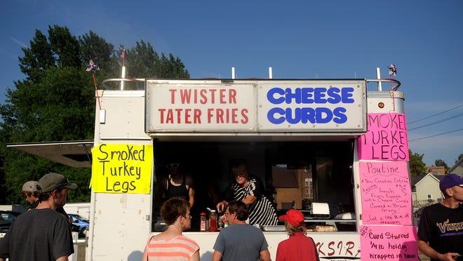 People wait in line for the favorite food at the annual Holdingford Daze celebration.
