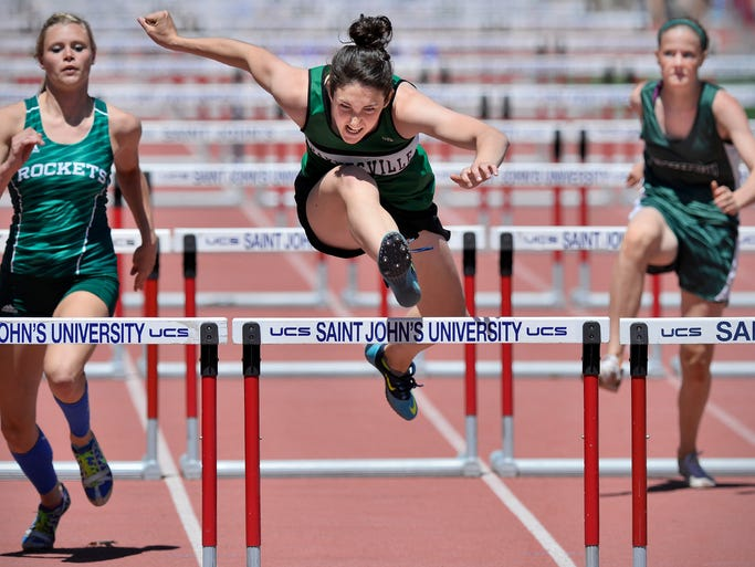 Paynesville's Kari Hoeft (center) flies over the last hurdle to win in the girls 100 meter hurdles during the Sect. 5A track meet Wednesday, May 28 at St. John's University.