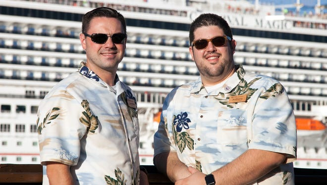 """""""The Cruise Guys"""" Jonathon Gersh and Anthony Garofalo of Expedia CruiseShipCenters in Melbourne watch the ships leave Port Canaveral."""
