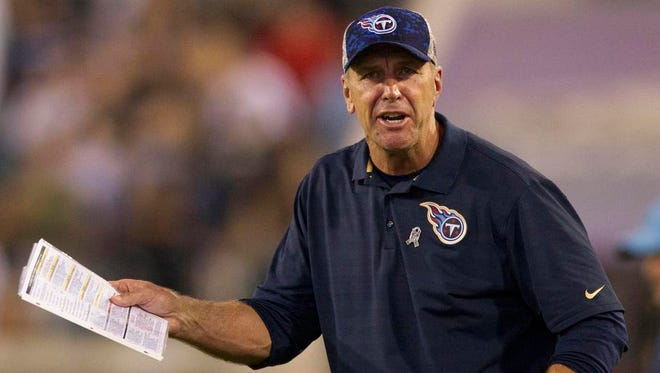 Titans interim coach Mike Mularkey yells during the fourth quarter.