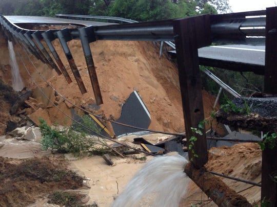 Scenic Highway has collapsed near Brookshire Drive.