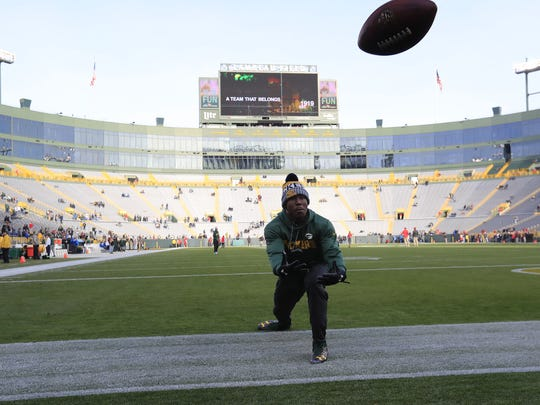 Green Bay Packers running back Jamaal Williams (30) plays catch with fans during pregame warmups at Lambeau Field on Sunday, December 3, 2017 in Green Bay, Wis.  Adam Wesley/USA TODAY NETWORK-Wisconsin