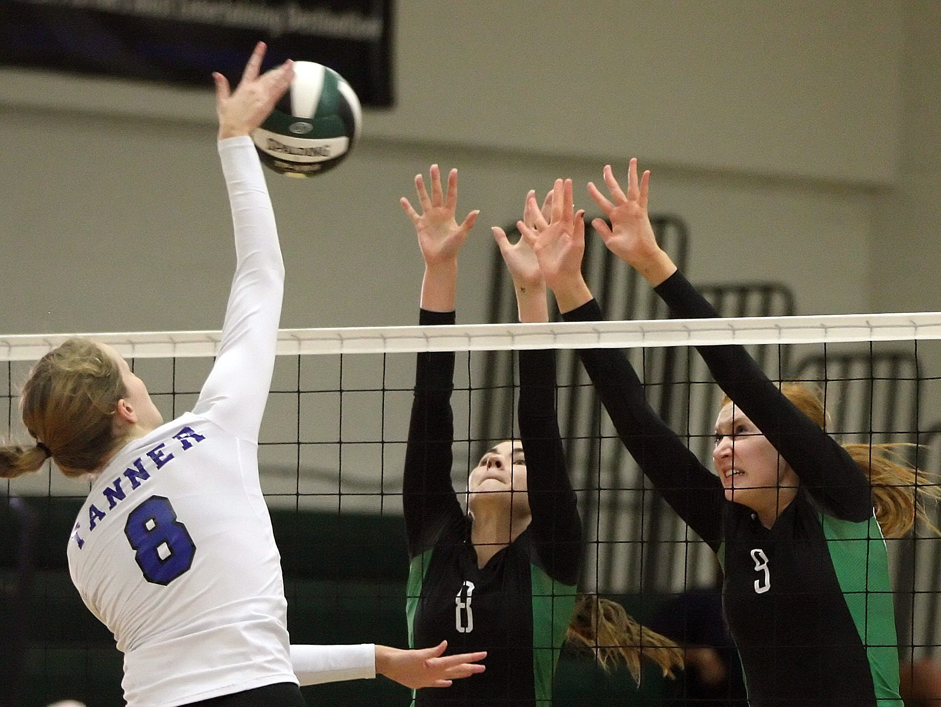 Fort Myers High School's Erin Gear and Kaitlin Stewart block Barron Collier's Julie Tanner's shot in the Region 6A-3 semifinal volleyball game Saturday at Fort Myers High School. Fort Myers beat Barron Collier 3-0.