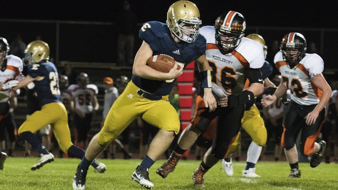Essex's Liam Coulter (25) runs with the ball during the high school football game between the Middlebury Tigers and the Essex Hornets at Essex High School on Friday night Octoer 7, 2016 in Essex.