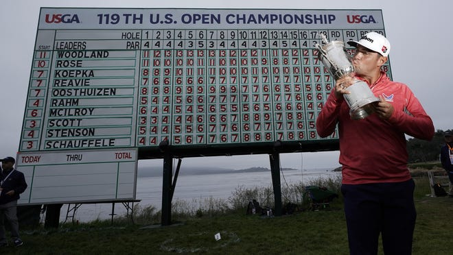 FILE - In this June 16, 2019, file photo, Gary Woodland poses with the trophy after winning the U.S. Open Championship golf tournament in Pebble Beach, Calif. Due to the coronavirus pandemic, the golf to watch on Father's Day this year will not be the U.S. Open as is usually the case.