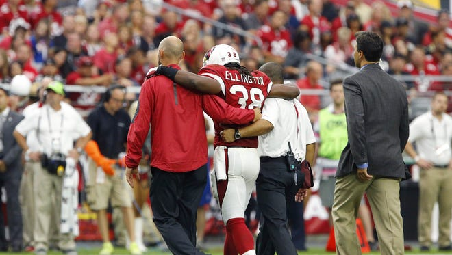 Arizona Cardinals running back Andre Ellington (38) is helped off the field the 4th quarter of the Cardinals a 31-19 win over the New Orleans Saints in their NFL game Sunday, Sept. 13, 2015 in Glendale, Ariz.