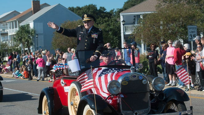 The 2015 Veterans Day parade winds its way down Bayfront Parkway Wednesday morning Nov. 11, 2015.