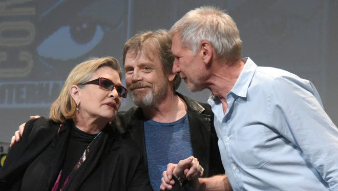 In this 2015 file photo, Carrie Fisher (from left), Mark Hamill and Harrison Ford attend a panel at Comic-Con International in San Diego, Calif. On Tuesday, a family publicist said Fisher died at the age of 60. With the loss of several icons of Generation X's youth, the year 2016 has left the generation born between the early 1960s and the early 1980s, wallowing in memories and contemplating its own mortality.