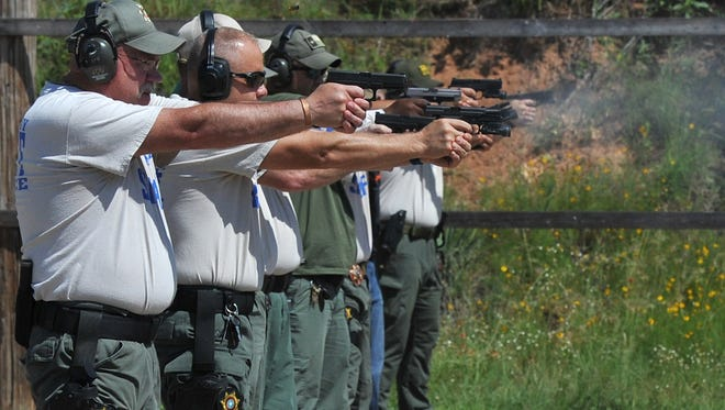 Wichita County deputies are seen training for the last time in  June at their old firing range near Burkburnett. The 20-year lease for the facility expired and the county about to start construction on a new $500,000 range near the Sprague Jail Annex.