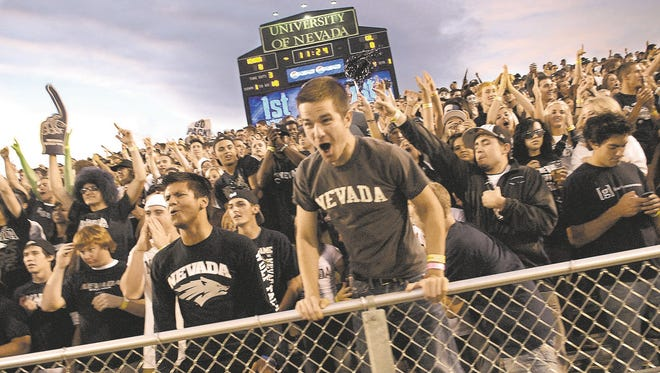 In 2010: Nevada football fans cheer for the Wolf Pack during the team's at Mackay Stadium.