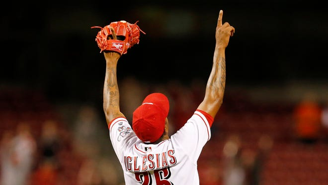 Cincinnati Reds relief pitcher Raisel Iglesias (26) celebrates a strikeout for the final out.