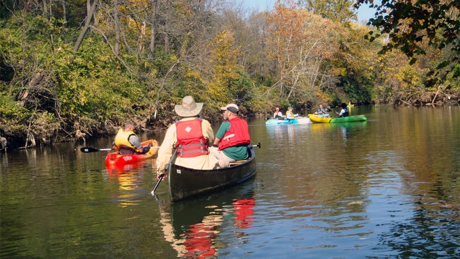 Members of the South River Remediation Advisory Panel and the South River Science Team take to the water on a recent fall afternoon. The group paddled through the city of Waynesboro from Constitution Park to Basic Park.