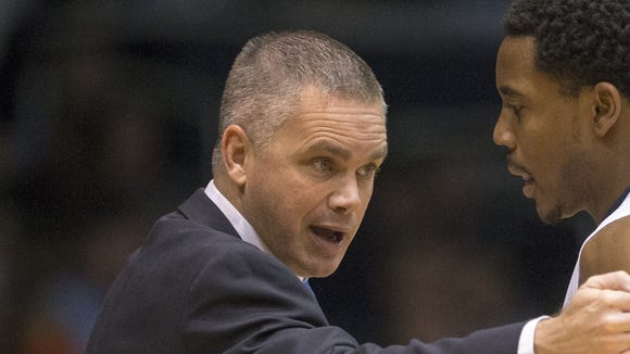 FILE -- Chris Holtmann, head coach, instructs butler player Jordan Gathers, as Butler beat Virginia Military Institute 93-66, at Hinkle Fieldhouse, Indianapolis, Monday, Dec. 7, 2015.