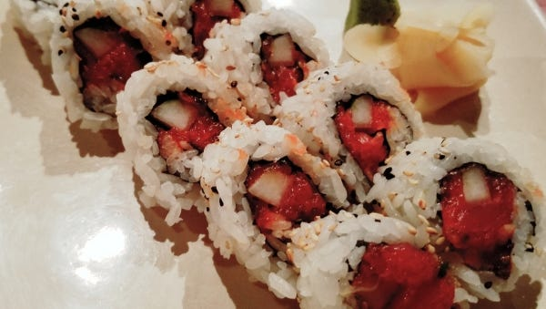 Sushi Yama's spicy tuna roll was ruby-red minced spicy tuna combined with cucumbers and scallions in a tight roll.