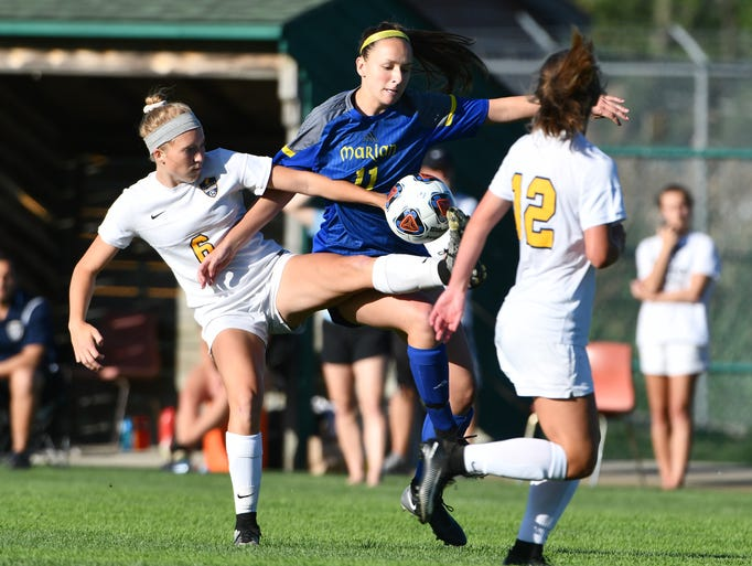 DeWitt's Kendra Brown and Marian's Annie Bruce battle