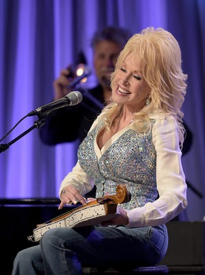 "Dolly Parton performs during a pre-taping for the ""Smoky Mountains Rise: A Benefit for the My People Fund"" telethon Tuesday, Dec. 13, 2016, in Nashville."