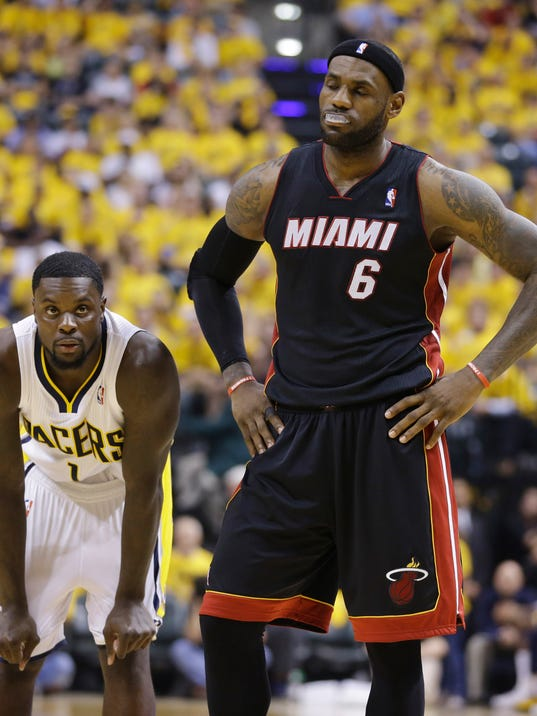 Miami Heat forward LeBron James (6) reacts to being called for a foul as Indiana Pacers guard Lance Stephenson (1) watches during the second half of Game 5 of the NBA basketball Eastern Conference finals in Indianapolis, Wednesday, May 28, 2014. (AP Photo/Michael Conroy)