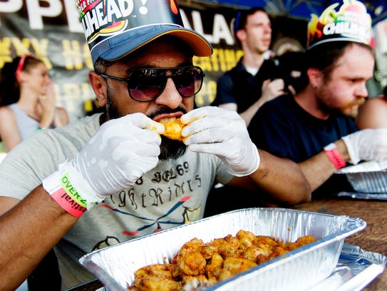 "Eisa Nuri, of Nashville, competes in the ""XXX Challenge"" at the annual Big Kahuna Wing Festival in World's Fair Park in Knoxville, Tennessee on Saturday, June 17, 2017. Between 8,000 to 10,000 people attended the event that featured 38 teams competing for a grand prize of $4,000."