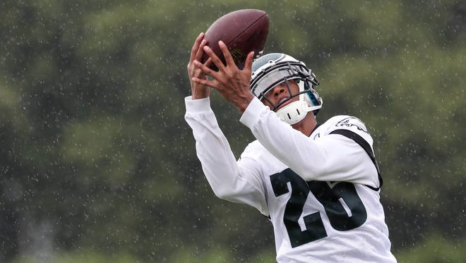 Philadelphia Eagles cornerback Cary Williams (26) catches the ball during training camp at the Novacare Complex in Philadelphia PA.