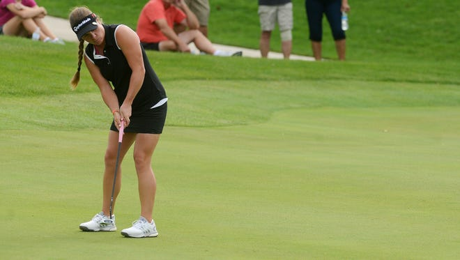 Dani Holmqvist of Stockholm, Sweden putts on the third green Sunday at the LPGA Symetra Tour, Sioux Falls GreatLIFE Challenge at Willow Run, Sept 6, 2015.