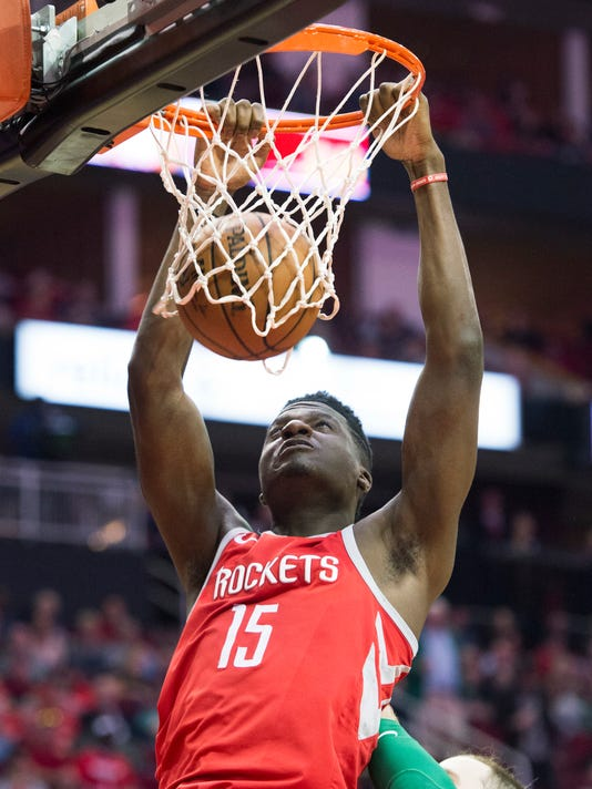Houston Rockets center Clint Capela dunks against the Boston Celtics during the first half of an NBA basketball game Saturday, March 3, 2018, in Houston. (AP Photo/George Bridges)