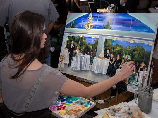 Artist Meredith Piper creates an on-the-spot painting of Matt and Alex Madden's wedding reception.