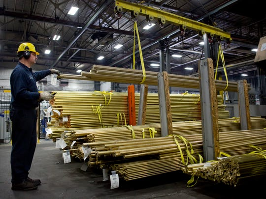 A worker uses a crane to stack bundles of completed brass rods Thursday at Mueller Brass in Port Huron. Mueller Brass received a tax abatement on $3.3 million of personal property in 2005 from the city of Port Huron. The company has put the money toward a ten-year upgrade project, which will be completed this fall.