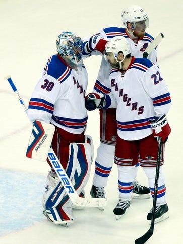 New York Rangers goalie Henrik Lundqvist (30) celebrates