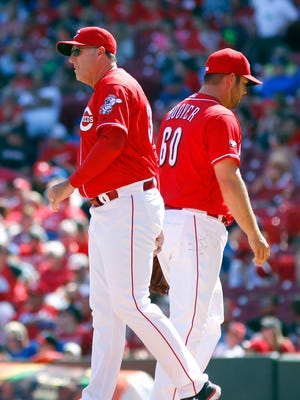 Reds manager Bryan Price takes the ball from relief pitcher J.J. Hoover during the eighth inning.