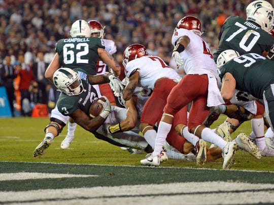 Michigan State Spartans running back LJ Scott (3) scores a touchdown during the second quarter against the Washington State Cougars in the 2017 Holiday Bowl at SDCCU Stadium.