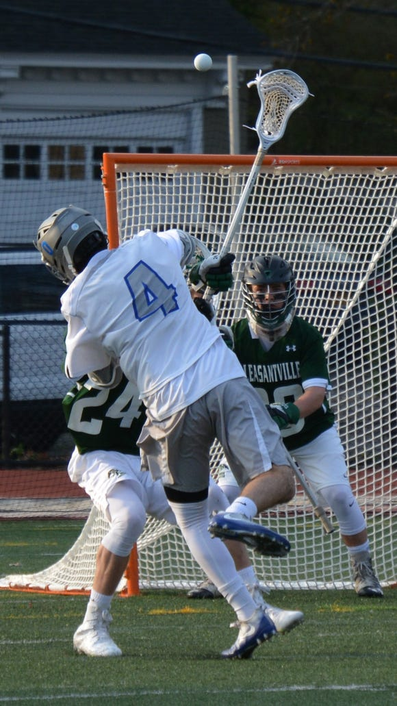 Bronxville's Ryan Alberghine reaches over a defender and gets a shot on Pleasantville goalie Jack Fitzgerald in the second half of the Broncos' 12-6 win on Thursday.
