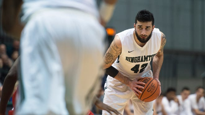 Binghamton University forward Willie Rodriguez handles the ball during the Bearcat's 62-52 loss to Stony Brook at home on Wednesday, Jan. 6, 2016.