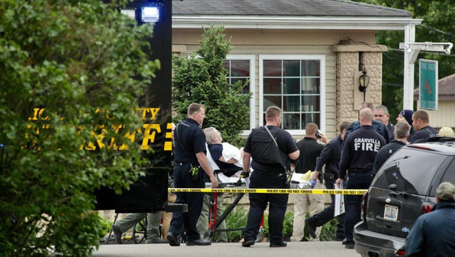 Residents of Pine Kirk Care Center in Kirkersville, Ohio, are relocated May 12, 2017, after a gunman killed the village police chief and two nursing-home employees before killing himself.