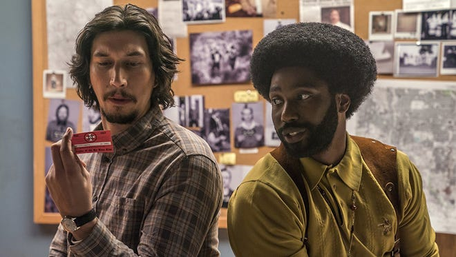 """John David Washington and Adam Driver star in """"BlacKkKlansman."""" Milwaukee Film says it will reopen the Oriental Theatre with the new Spike Lee movie Aug. 10."""