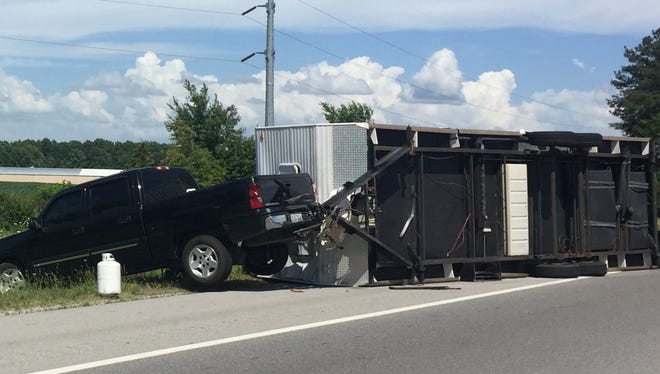 A trailer being pulled by a truck is overturned on I-24 in Manchester near the entrance to Bonnaroo.