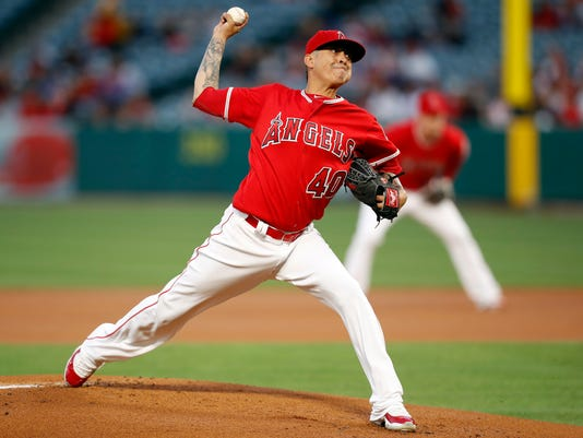 Los Angeles Angels starting pitcher Jesse Chavez throws a pitch against the Texas Rangers during the first inning of a baseball game, Wednesday, April 12, 2017, in Anaheim, Calif. (AP Photo/Ryan Kang)