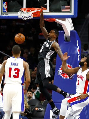 Dewayne Dedmon of the San Antonio Spurs gets a first-half dunk between Marcus Morris and Andre Drummond during the Spurs' 103-92 win over the Detroit Pistons at the Palace on Feb. 10, 2017.