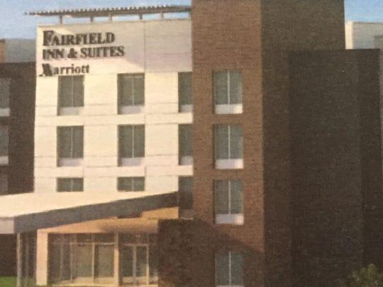 Developers break ground Wednesday at Marriott's Fairfield Inn & Suites.
