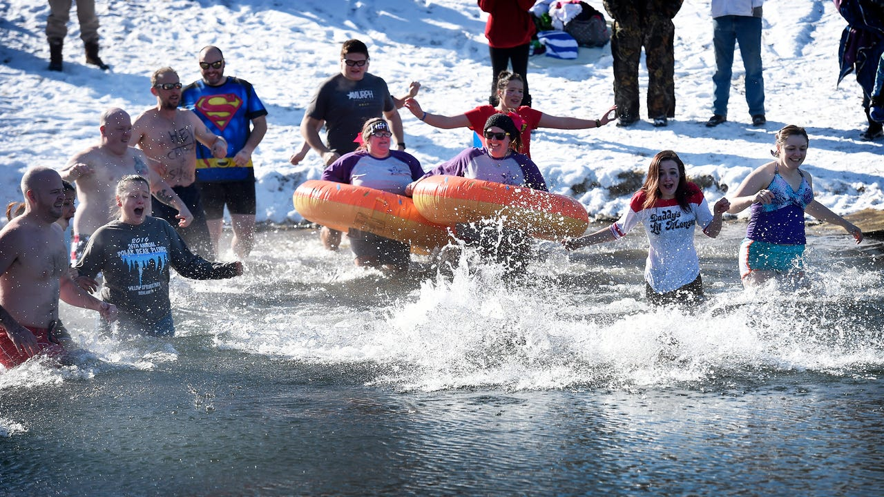 Those brave enough to endure the severe cold temperatures jumped into Willow Springs Park Lake in Richland Jan. 1, at noon, for the 28th Annual Polar Bear Club Plunge. The annual event is a benefit for the Developmental & Disabilty Services of Lebano