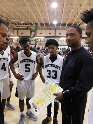 The Northwest High boys' basketball team ended a two-game losing streak and began District 5-3A on Tuesday night with a 74-41 win over Iota in a game played at the Raiders' gym. Northwest boys' coach Chester Randell is shown here talking to his team during the St. Landry Parish Basketball Tournament played in Eunice last month. Northwest won that tournament.