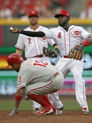 Cincinnati Reds second baseman Brandon Phillips (4) makes a throw to first base to turn a double play.